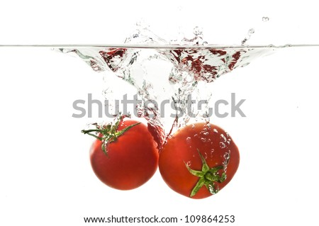 Tomato in Water - stock photo
