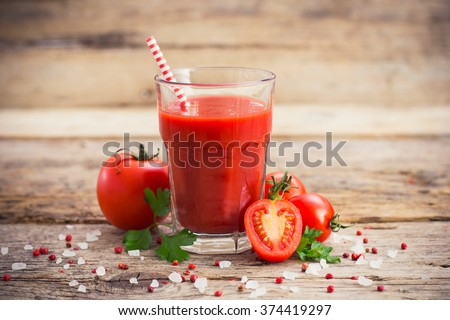 Tomato juice in the glass - stock photo