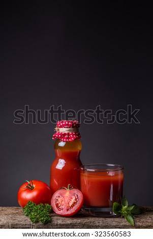 Tomato juice on vintage wooden board - stock photo