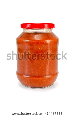 Tomato ketchup in a glass jar isolated on white background - stock photo