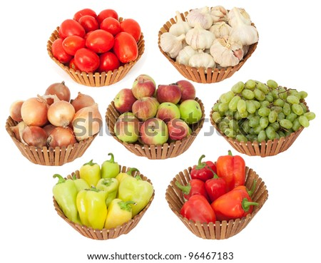 tomato, onion, garlic, peppers, apples and grapes on a white background - stock photo