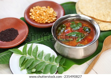 tomato rasam, south indian soup - stock photo
