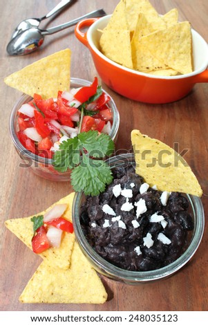 tomato-salsa and black-bean-mush - stock photo