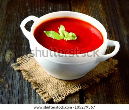 Tomato sauce on wood. - stock photo