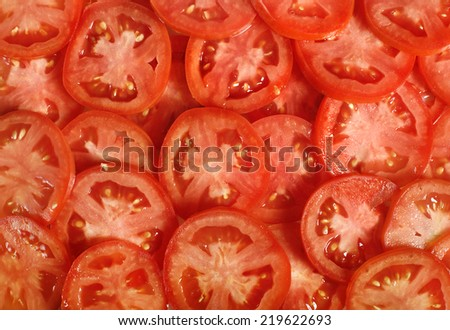 Tomato slices. Natural background with slices of tomato. - stock photo