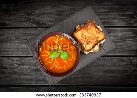 Tomato soup and grilled cheese sandwiches - stock photo
