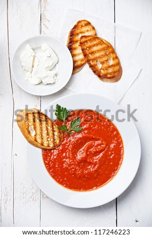 Tomato soup Gazpacho on white wooden background - stock photo