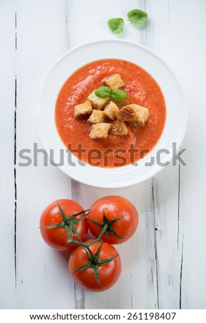Tomato soup Gazpacho over white wooden background, above view - stock photo