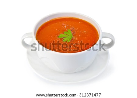 Tomato soup in a bowl with parsley and spices on a saucer isolated on a white background - stock photo
