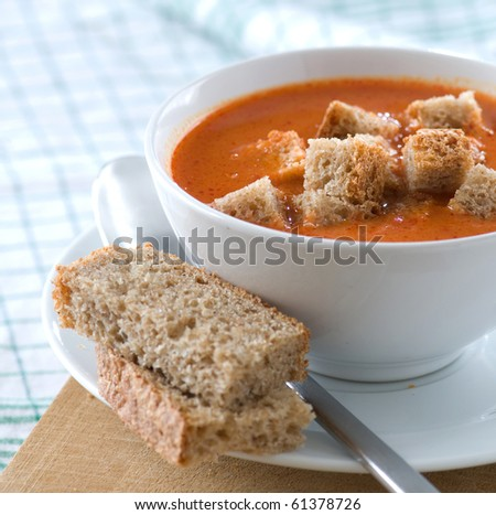 tomato soup with bread - stock photo