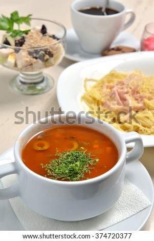 tomato soup with greens and olives - stock photo