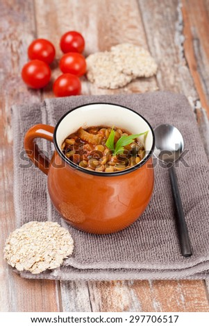 tomato soup with lentil, celery and sweet pepper garnished with fresh parsley, horizontal - stock photo