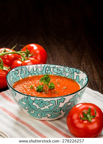Tomato soup with Napkin and fresh tomatoes. - stock photo