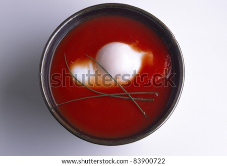 Tomato soup with poached egg - stock photo