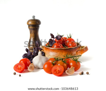 Tomatoes, a basil in a mortar, garlic and spices are isolated on a white background - stock photo