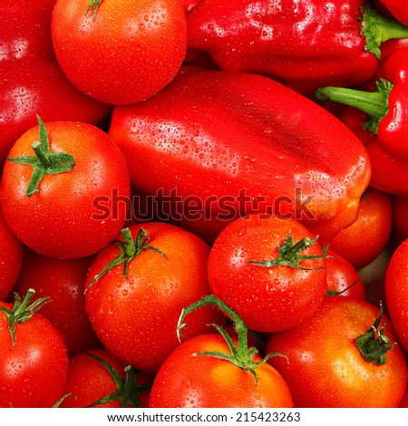 Tomatoes and peppers as background. - stock photo