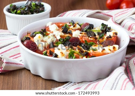 Tomatoes baked with cheese feta, smoked sausages, herbs, olives ...