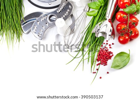 Tomatoes, chives and blender for cooking - stock photo