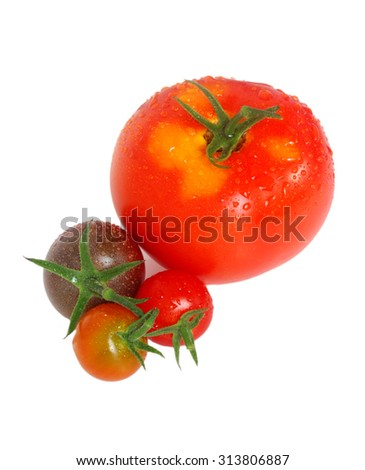 Tomatoes drenched in water droplets - stock photo