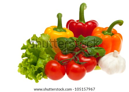 Tomatoes, garlic, lettuce, peppers, basil shot on a white background. - stock photo