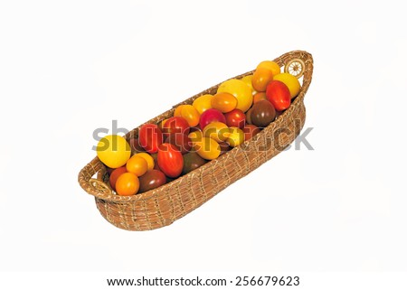 tomatoes in a basket isolated on a white background. - stock photo