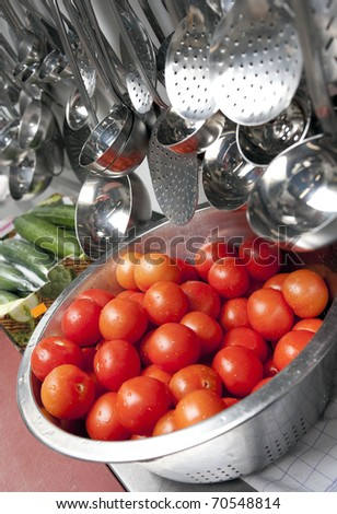 tomatoes in a stainless steel colander - stock photo
