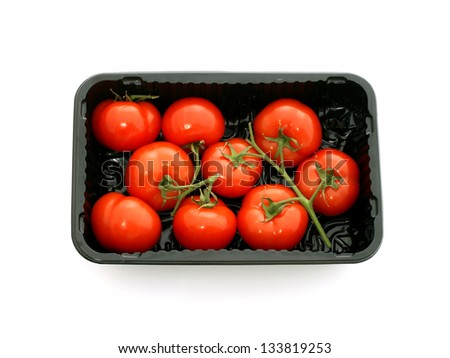 Tomatoes in plastic packing isolated on white background - stock photo
