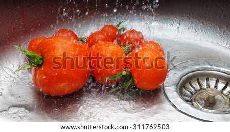 tomatoes in the sink - stock photo