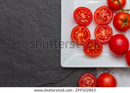 Tomatoes of vegetables on background. - stock photo