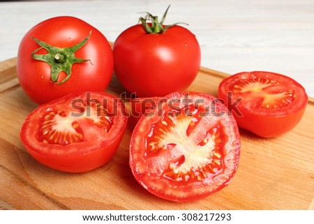 Tomatoes on cutting board - stock photo