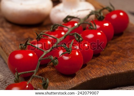Tomatoes on the cutting board - stock photo