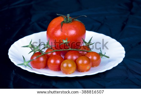 Tomatoes on white plate, black background,white, tomato, plate ,red tomatoes,food, healthy,fresh, herbs,green, healthy food, vegetable, ingredient,closeup, natural,garden, freshness,fresh vegetables, - stock photo