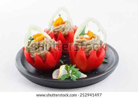 Tomatoes stuffed with eggplant baba ganoush - stock photo
