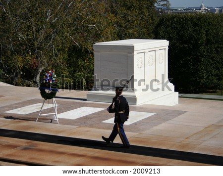 Tomb of the unknown soldier Arlington cemetery with honor guard marching - stock photo