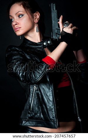 Tomb Raider style woman on black background - stock photo