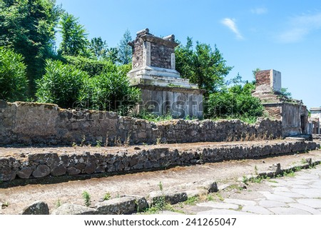 Tombs at ruins of ancient city Pompeii, destroyed by volcanic eruption of Vesuvio mountain, Italy - stock photo