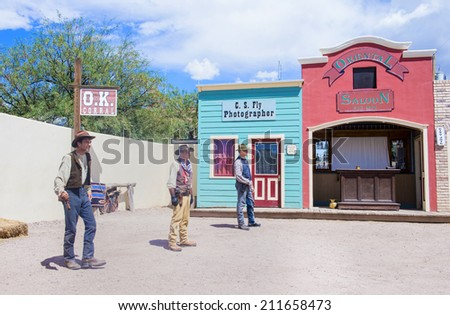 TOMBSTONE , ARIZONA - AUG 09 : Actors take part in the Re-enactment of the OK Corral gunfight in Tombstone , Arizona on August 09 2014.  - stock photo