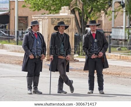 TOMBSTONE , ARIZONA - May 11 : Actors take part in the Re-enactment of the OK Corral gunfight in Tombstone , Arizona on May 11, 2015. - stock photo