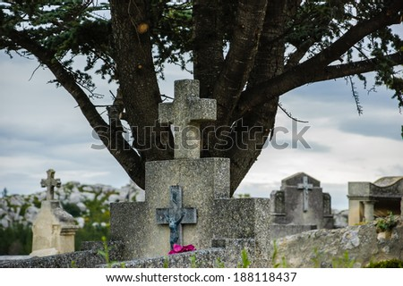 Tombstone with the cross and crucifix at the old cemetery in Les Baux-de-Provence (Provence, France).  - stock photo
