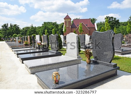 Tombstones and a chapel in the public cemetery - stock photo