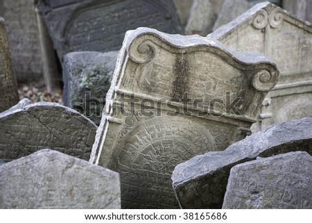 Tombstones in the old Jewish cemetery in Prague - stock photo