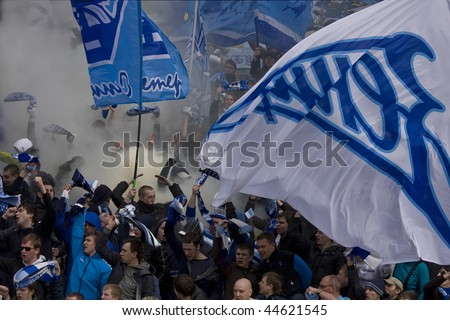 TOMSK, RUSSIA - APRIL 5: Fans of Football Club Zenit at the match Championship of Russia among Tom'(Tomsk) - Zenit (Spb), April 5, 2009 in Tomsk, Russia. - stock photo