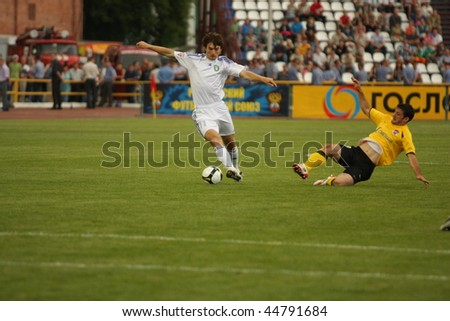 TOMSK, RUSSIA - JULY 19: Football match Championship of Russia among Tom'(Tomsk) - Khimki (Khimki), July 19, 2009 in Tomsk, Russia. - stock photo