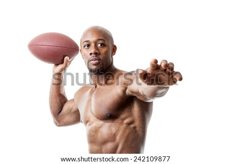Toned and ripped athletic quarterback throwing a football isolated over a white background.    - stock photo