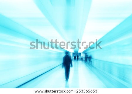 Toned blurred image of people in tunnel.  - stock photo