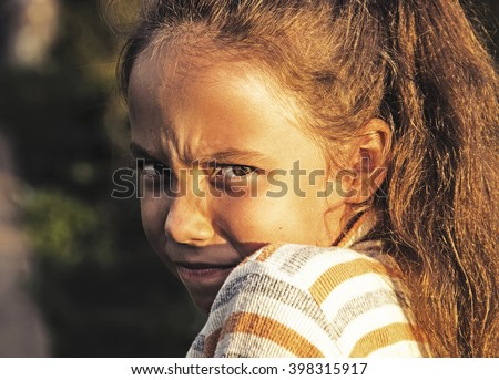 Toned Closeup portrait of Scared and angry cute little girl. - stock photo