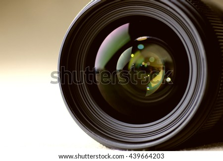 toned monochrome background of lens flare object - stock photo