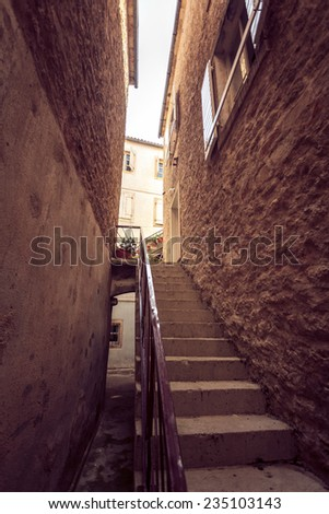 Toned photo of big stairway at old narrow street - stock photo