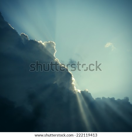 Toned photo of Dramatic Cloudscape Area with Ray of Light - stock photo