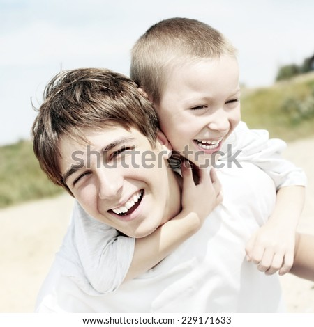 Toned Photo of Happy Brothers Portrait outdoor - stock photo